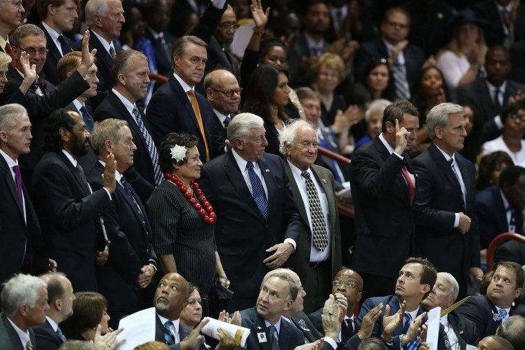 Congress people stand as they are introduced at the College Charleston TD Arena during the funeral of South Carolina State Sen. Clementa Pinckney who was killed during the mass shooting at the Emanuel African Methodist Episcopal Church along with eight others on June 26, 2015 in Charleston, South Carolina. Suspected shooter Dylann Roof, 21 years old, is accused of killing nine people on June 17th during a prayer meeting in the church, which is one of the nation's oldest black churches in Charleston. (Photo by Joe Raedle/Getty Images)