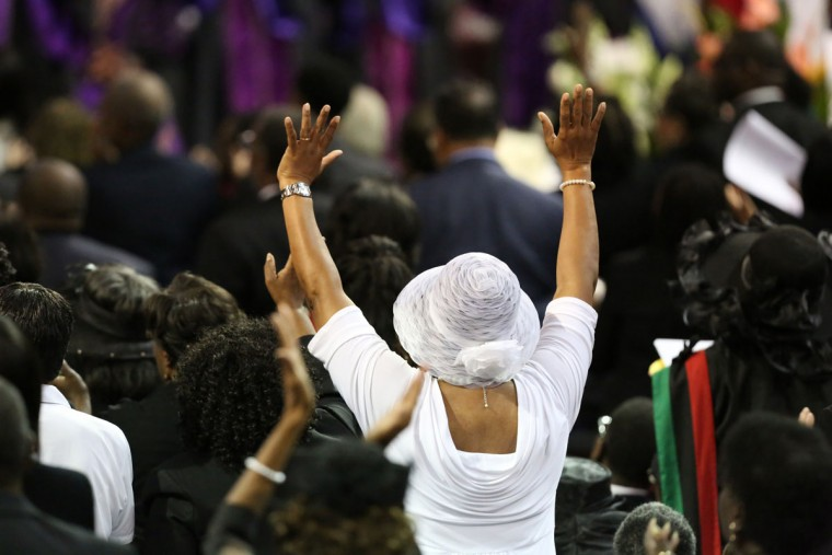 Mourners pay their respects at the funeral service for Sen. Clementa Pinckney at the College Charleston TD Arena for South Carolina State Sen. Clementa Pinckney who was killed during the mass shooting at the Emanuel African Methodist Episcopal Church along with eight others on June 26, 2015 in Charleston, South Carolina. Suspected shooter Dylann Roof, 21 years old, is accused of killing nine people on June 17th during a prayer meeting in the church, which is one of the nation's oldest black churches in Charleston. (Photo by Grace Beahm-Pool/Getty Images)