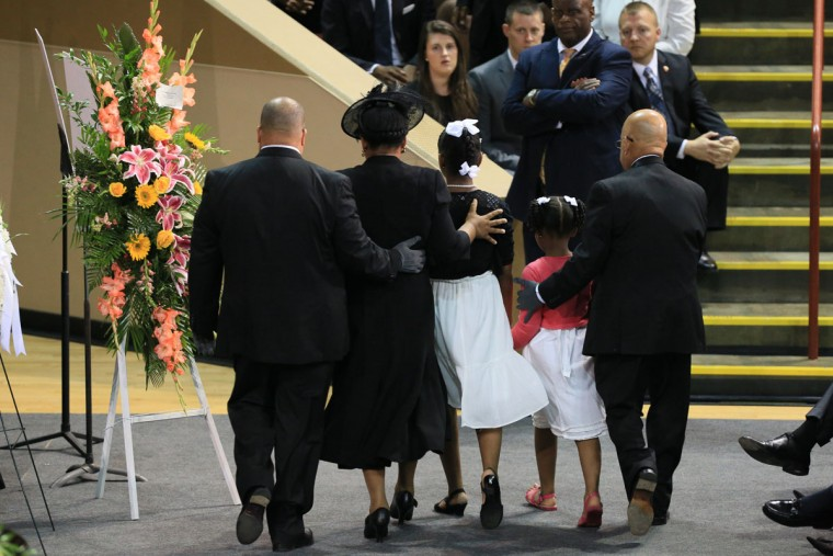 The family of Sen. Clementa Pinckney is guided through the College Charleston TD Arena for South Carolina State Sen. Clementa Pinckney who was killed during the mass shooting at the Emanuel African Methodist Episcopal Church along with eight others on June 26, 2015 in Charleston, South Carolina. Suspected shooter Dylann Roof, 21 years old, is accused of killing nine people on June 17th during a prayer meeting in the church, which is one of the nation's oldest black churches in Charleston.. (Photo by Paul Zoeller-Pool/Getty Images)