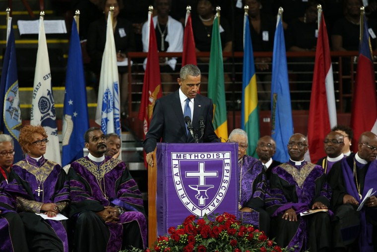 U.S. President Barack Obama delivers the eulogy for South Carolina state senator and Rev. Clementa Pinckney during Pinckney's funeral service June 26, 2015 in Charleston, South Carolina. Suspected shooter Dylann Roof, 21, is accused of killing nine people on June 17th during a prayer meeting in the church, which is one of the nation's oldest black churches in Charleston. (Photo by Win McNamee/Getty Images)