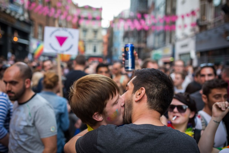Men kiss in Soho following the annual Pride in London Parade on June 27, 2015 in London, England. Pride in London is one of the world's biggest LGBT+ celebrations as thousands of people take part in a parade and attend performances at various locations across the city. (Rob Stothard/Getty Images)