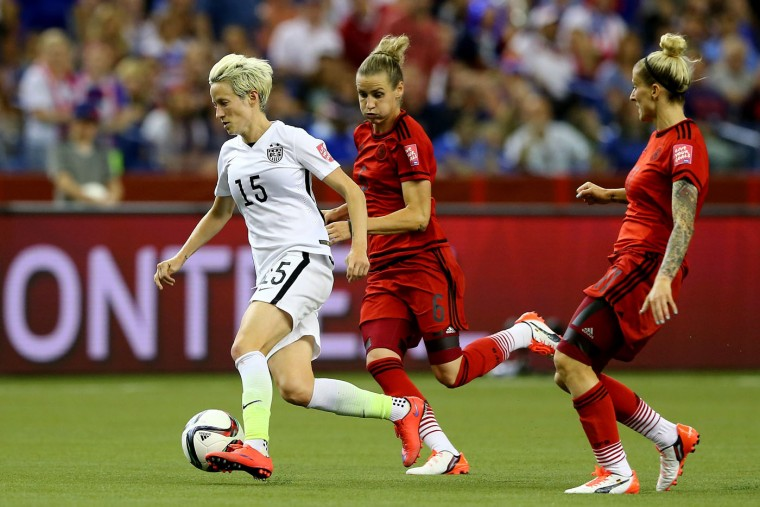 Megan Rapinoe #15 of the United States runs ahead of Simone Laudehr #6 of Germany in the second half in the FIFA Women's World Cup 2015 Semi-Final Match at Olympic Stadium on June 30, 2015 in Montreal, Canada. (Elsa/Getty Images)