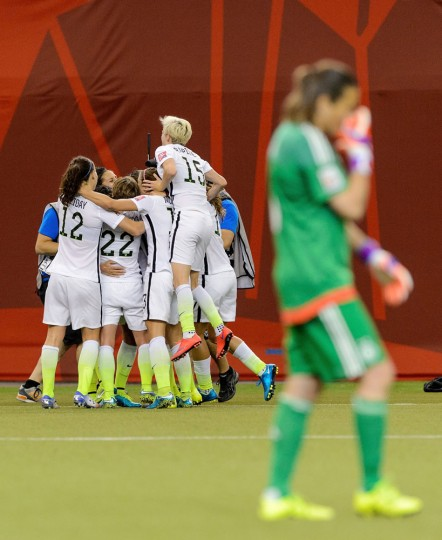 Carli Lloyd #10 of the United States celebrates with teammates after scoring on a penalty kick for the opening goal against Germany in the FIFA Women's World Cup 2015 Semi-Final Match at Olympic Stadium on June 30, 2015 in Montreal, Canada. (Minas Panagiotakis/Getty Images)