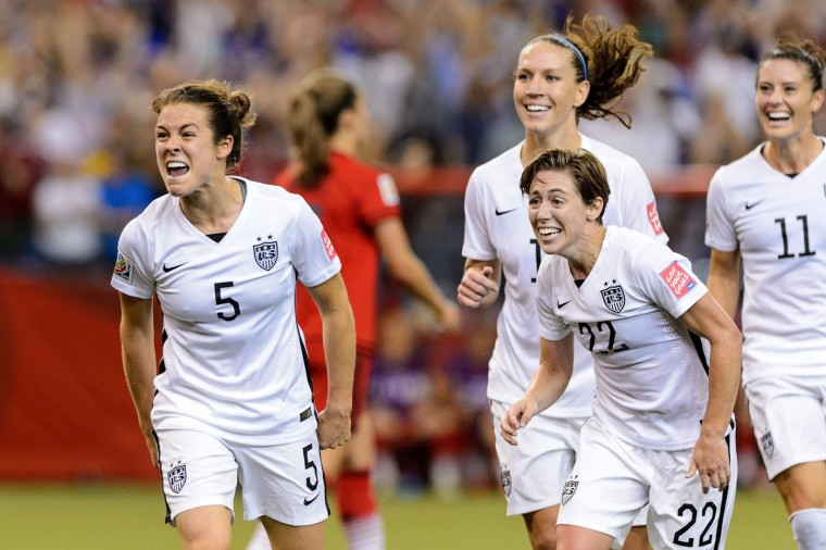 Kelley O'Hara #5 of the United States celebrates with teammates after scoring a goal in the second half against Germany in the FIFA Women's World Cup 2015 Semi-Final Match at Olympic Stadium on June 30, 2015 in Montreal, Canada. (Minas Panagiotakis/Getty Images)