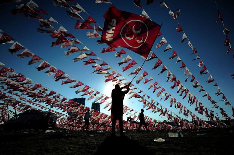 A woman waves a flag of Turkeys Nationalist Movement Party (MHP) during an election campaign rally on May 31, 2015 at Kazlicesme neighborhood in Istanbul ahead of the June 7 general elections. Turkish police tightened security around Istanbul's Taksim square, on the second anniversary of the mass anti-government protests that rocked the square in 2013. (AFP Photo/P /ozan )