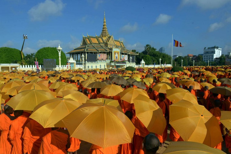 """Cambodian Buddhist monks gather in front of the Royal Palace in Phnom Penh to attend a ceremony after Cambodia's King Norodom Sihamoni received the honorary title """"Preah Sri Loka Dhammika Raja"""" from the World Buddhist Supreme Conference. (Tang Chhin Sothy/Getty Images)"""