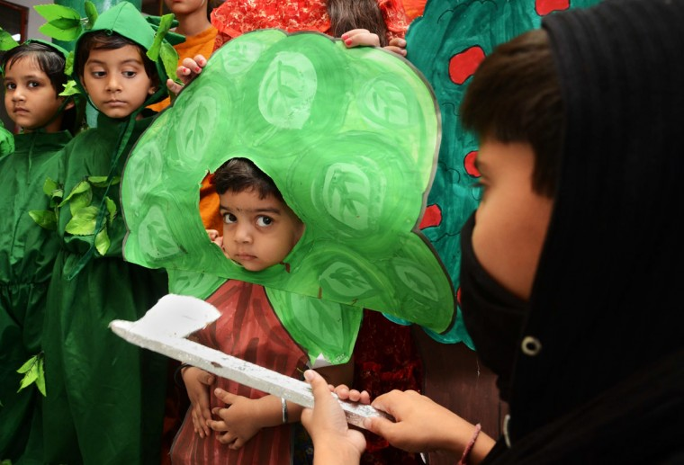 Indian schoolchildren dressed as trees take part in an event to highlight environmental issues on the eve of World Environment Day in Amritsar on June 4, 2015. World Environment Day is marked annually on June 5. (Nanu Narinder/AFP/Getty Images)