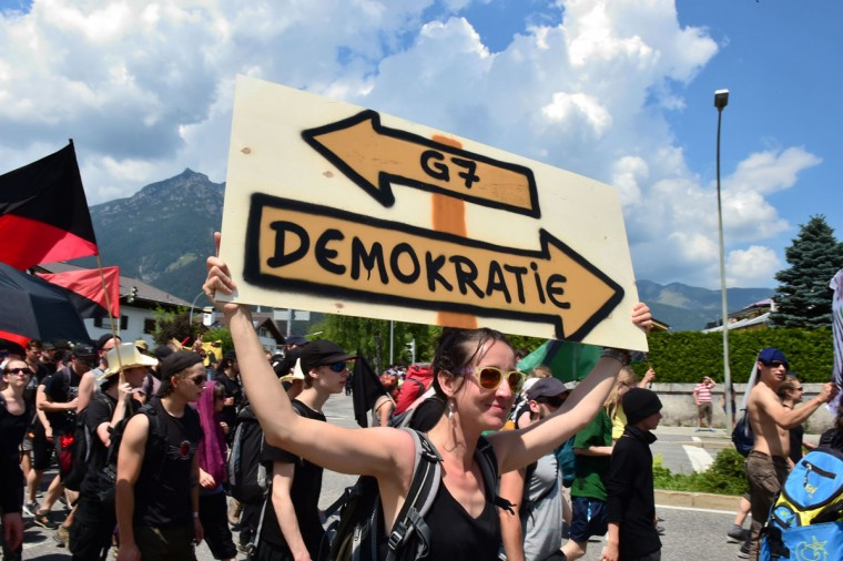 Anti G7-protesters demonstrate in Garmisch-Partenkirchen, southern Germany on June 6, 2015, ahead of the G7 summit. Germany will host the G7 summit at Elmau Castle on June 7 and June 8, 2015. (AFP Photo/John Macdougall)
