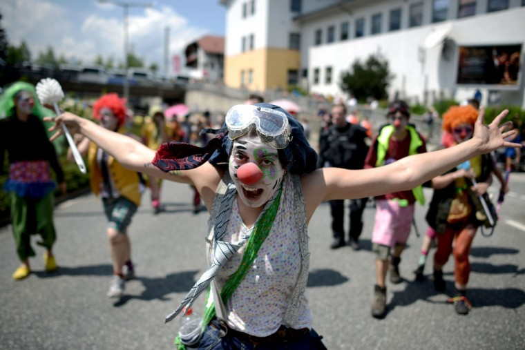 An anti-G7 protester gestures during a rally in Garmisch-Partenkirchen, southern Germany on June 6, 2015, ahead of the G7 summit. Germany will host the G7 summit at Elmau Castle on June 7 and June 8, 2015. (AFP Photo/Philipp Guelland)