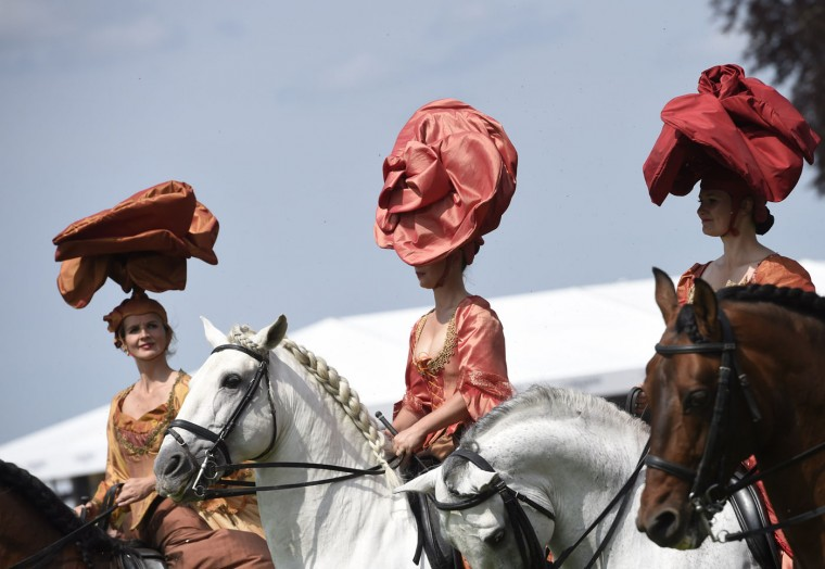 Women dressed in period costume ride horses before the start of the 166th Prix de Diane, a 2100-metre flat horse race open to three-year-old thoroughbred fillies, on June 14, 2015 in Chantilly, outside Paris. (Miguel Medina/AFP/Getty Images)