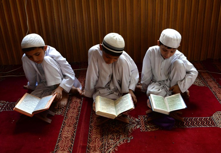 Afghan children study the Quran during first day of the month of Ramadan at a mosque in Jalalabad on June 18, 2015, Islam's holy month of Ramadan, which is calculated on the sighting of the new moon, will begin on June 18 in Afghanistan. (Noorullah Shirzada/AFP/Getty Images)