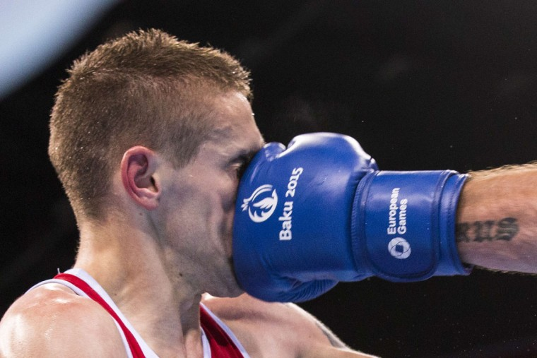 Croatia's Matteo Komadina (red) fights with Israel's Igor Lazarev during the mens light (60kg) round of 32 boxing fight at the 2015 European Games in Baku on June 18, 2015. (JACK GUEZ/AFP/Getty Images)