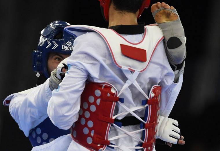 Portugal's Julio Ferreira (blue) competes against Azerbaijan's Milad Beigi Harchegani during their Taekwondo men's -80kg semifinal fight at the 2015 European Games in Baku on June 18, 2015. (TOBIAS SCHWARZ/AFP/Getty Images)