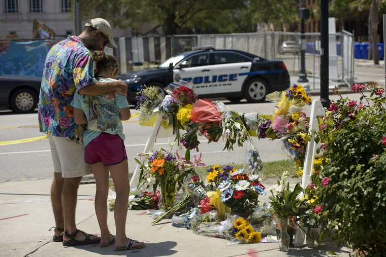 People visit a makeshift memorial near the Emanuel AME Church June 18, 2015 in Charleston, South Carolina, after a mass shooting at the Church on the evening of June 17, 2015. (BRENDAN SMIALOWSKI/AFP/Getty Images)