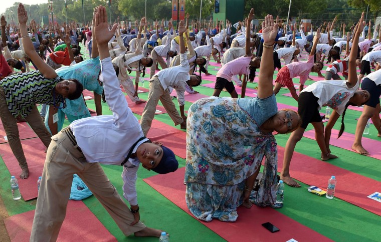 Indian yoga practitioners participate in full dress rehearsal for International Yoga Day in New Delhi on June 19, 2015. The heart of India's capital will transform into a sea of colourful mats on June 21, 2015 as thousands perform the camel, cobra and other postures for the first international Yoga Day championed by Narendra Modi.. (AFP Photo/P /prakash )