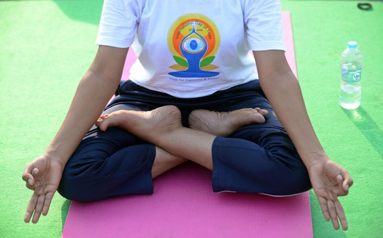 Indian yoga practitioners participate in a full dress rehearsal for International Yoga Day in New Delhi on June 19, 2015. The heart of India's capital will transform into a sea of colourful mats on June 21, 2015, as thousands perform the camel, cobra and other postures for the first international Yoga Day championed by Narendra Modi. (AFP Photo/P /prakash )