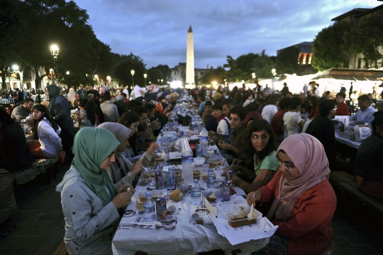 Thousands of Turkish people break their fasting on June 18, 2015 at the Blue Mosque square in Istanbul, during the first day of the holy month of Ramadan. During Ramadan, Muslim believers abstain from eating, drinking, smoking and having sex from dawn until sunset. Ramadan is sacred to Muslims because it is during that month that tradition says the Koran was revealed to the Prophet Mohammed. The fast is one of the five main religious obligations under Islam. (AFP Photo/P /ozan )