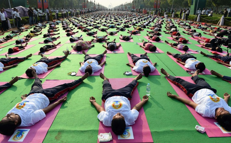 Indian yoga practitioners participate in a full dress rehearsal for International Yoga Day in New Delhi on June 19, 2015. The heart of India's capital will transform into a sea of colourful mats on June 21, 2015, as thousands perform the camel, cobra and other postures for the first international Yoga Day championed by Narendra Modi.. (AFP Photo/P /prakash )