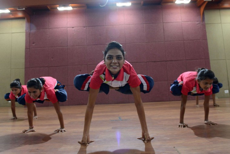 Young Indian girls from the Yoga and Cultural Association of Gujarat practice yoga in Ahmedabad on June 18, 2015. Gujarat's girls yoga team is invited to perform at New Delhi's Vigyan Bhavan, on the occasion of International Yoga Day on June 21, 2015. (AFP Photo/Sam Panthaky)