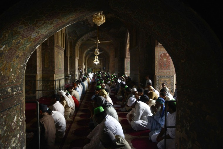 Pakistani Muslims offer first Friday prayers during the Muslim fasting month of Ramadan at the masjid Wazir Khan in Lahore on June 19, 2015. Islam's holy month of Ramadan is celebrated by Muslims worldwide marked by fasting, abstaining from foods, sex and smoking from dawn to dusk for soul cleansing and strengthening the spiritual bond between them and the Almighty. (AFP Photo/Arif Ali)