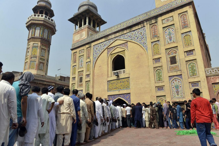 Pakistani Muslims arrive to offer first Friday prayers during the Muslim fasting month of Ramadan at the masjid Wazir Khan in Lahore on June 19, 2015. Islam's holy month of Ramadan is celebrated by Muslims worldwide marked by fasting, abstaining from foods, sex and smoking from dawn to dusk for soul cleansing and strengthening the spiritual bond between them and the Almighty. (AFP Photo/Arif Ali)