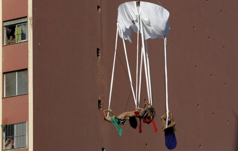 "Brazilian acrobats hanging from wires during the annual ""Virada Cultural"" event, in Sao Paulo, Brazil, on June 21, 2015. (Miguel Schincariol/AFP/Getty Images)"