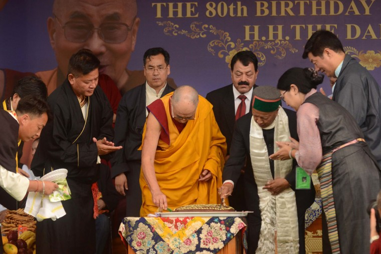 Tibetan Spiritual leader the Dalai Lama (C) is accompanied by The Chief Minister of the northern Indian state of Himachal Pradesh Virbhadra Singh (3R), leader of the Tibetan government-in-exile, Lobsang Sangay (R) and others as he cuts a cake during an event to celebrate his 80th birthday at Tsuglakhang Temple in McLeod Ganj on June 22, 2015. The Dalai Lama marked his official 80th birthday on June 21, with prayers and celebrations at his hometown in exile but little to show for decades of lobbying for greater Tibetan autonomy. (AFP Photo/Narinder Nanu)