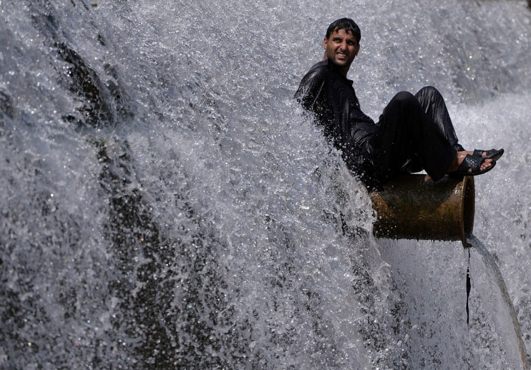 A Pakistani man cools off at a river during a heatwave on the outskirts of Islamabad on June 22, 2015. A heatwave in Pakistan's largest city Karachi and other districts of southern Sindh province has killed at least 122 people, health officials said. The southern port city of Karachi saw temperatures reach as high as 45 degrees Celsius (111 degrees Fahrenheit) on June 20, just short of an all-time high in the city of 47 C in June 1979. (Aamir Qureshi/AFP/Getty Images)