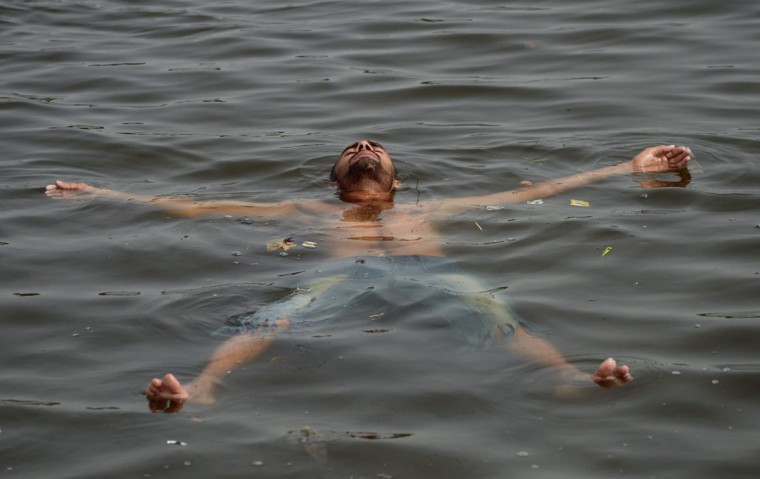 A Pakistani youth cools off in the sea during a heatwave in Karachi on June 22, 2015. Nearly 200 people have died in a heatwave in southern Pakistan, officials said, as the government called in the army to help tackle widespread heatstroke in the worst-hit city Karachi. (Rizwan Tabassum/AFP/Getty Images)