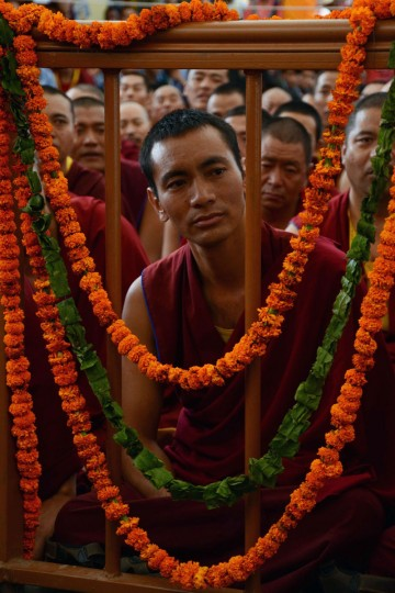 Tibetan Buddhist monks listen to the Dalai Lama speaking at an event to celebrate his 80th birthday at Tsuglakhang temple in McLeod Ganj on June 22, 2015. The Dalai Lama marked his official 80th birthday on June 21, with prayers and celebrations at his hometown in exile but little to show for decades of lobbying for greater Tibetan autonomy. (AFP Photo/Narinder Nanu)