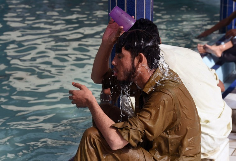 A Pakistani Muslim man cools down with water at a mosque during a heatwave in Karachi on June 22, 2015. Nearly 200 people have died in a heatwave in southern Pakistan, officials said as the government called in the army to help tackle widespread heatstroke in the worst-hit city Karachi. (Asif Hassan/AFP/Getty Images)