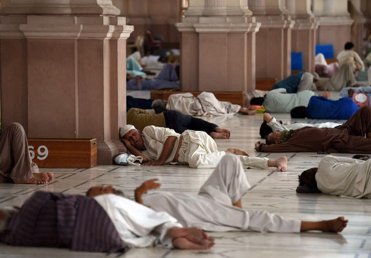 Pakistani Muslims rest at a mosque during a heatwave in Karachi on June 22, 2015. Nearly 200 people have died in a heatwave in southern Pakistan, officials said as the government called in the army to help tackle widespread heatstroke in the worst-hit city Karachi. (Asif Hassan/AFP/Getty Images)