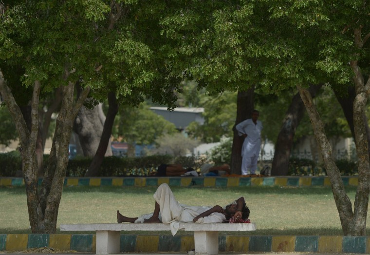 A Pakistani man rests under the shade of trees during a heatwave in Karachi on June 23, 2015. More than 500 people have died from a three-day heatwave in southern Pakistan, officials said as medics battled to treat victims after a state of emergency was declared in hospitals. The majority of the deaths occurred in the port city of Karachi, Pakistan's economic hub of around 20 million people, where temperatures reached 45 degrees Celsius (111 Fahrenheit), said Sabir Memon, a senior provincial health official. (Rizwan Tabassum/AFP/Getty Images)