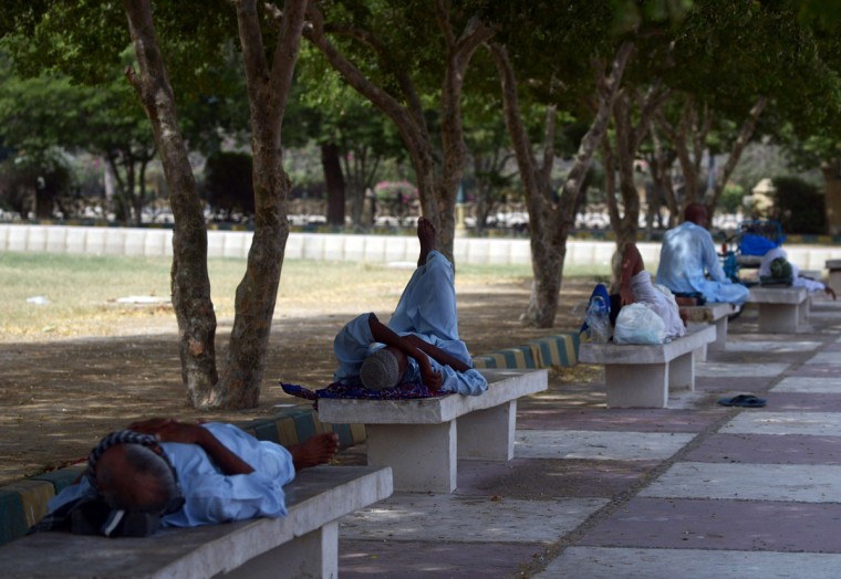 Pakistani men rest in the shade of trees during a heatwave in Karachi on June 23, 2015. More than 500 people have died from a three-day heatwave in southern Pakistan, officials said as medics battled to treat victims after a state of emergency was declared in hospitals. The majority of the deaths occurred in the port city of Karachi, Pakistan's economic hub of around 20 million people, where temperatures reached 45 degrees Celsius (111 Fahrenheit), said Sabir Memon, a senior provincial health official. (Rizwan Tabassum/AFP/Getty Images)