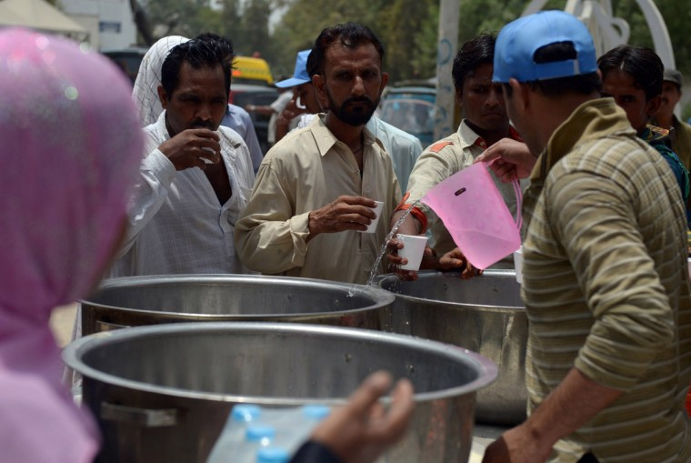 Pakistani volunteers provide drinking water to people outside a government hospital during a heatwave in Karachi on June 23, 2015. More than 500 people have died from a three-day heatwave in southern Pakistan, officials said as medics battled to treat victims after a state of emergency was declared in hospitals. The majority of the deaths occurred in the port city of Karachi, Pakistan's economic hub of around 20 million people, where temperatures reached 45 degrees Celsius (111 Fahrenheit), said Sabir Memon, a senior provincial health official. (Rizwan Tabassum/AFP/Getty Images)