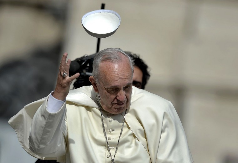 A gust of wind blows away Pope Francis' skullcap as he arrives to lead the weekly audience atSaint Peter's Square in the Vatican on June 24, 2015. (FILIPPO MONTEFORTE/AFP/Getty Images)