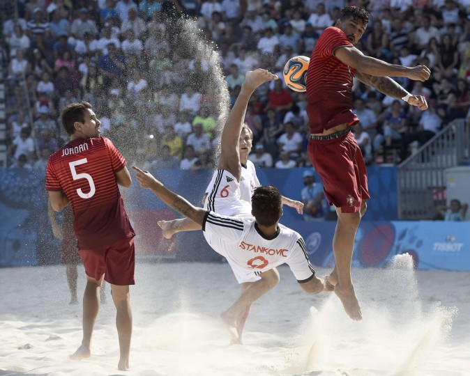 Dejan Stankovic (center) of Switzerland kicks the ball during the Beach soccer match Portugal vs Switzerland at the Baku 2015 European Games in Baku June 24, 2015. (TOBIAS SCHWARZ/AFP/Getty Images)
