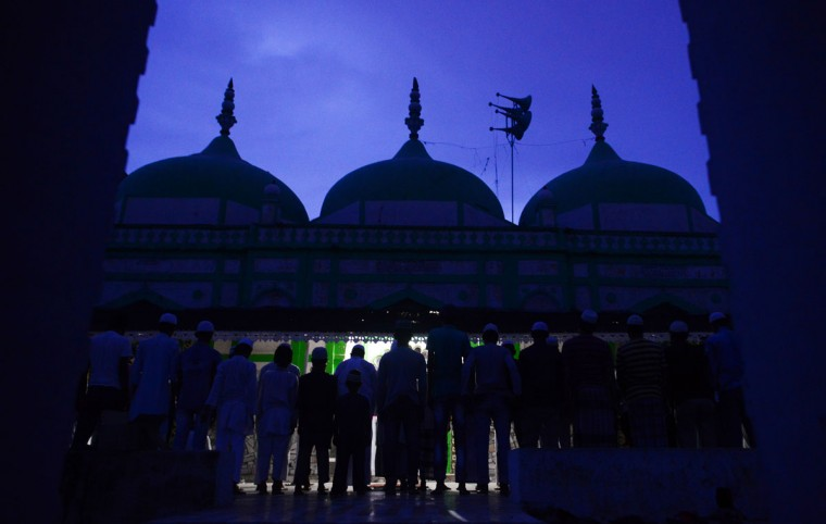 Indian Muslim devotees offer prayers after breaking their fast at Badi Masjid on the banks of the River Ganga in the Daraganj area of Allahabad on June 24, 2015. (Sanjay Kanojia/AFP/Getty Images)