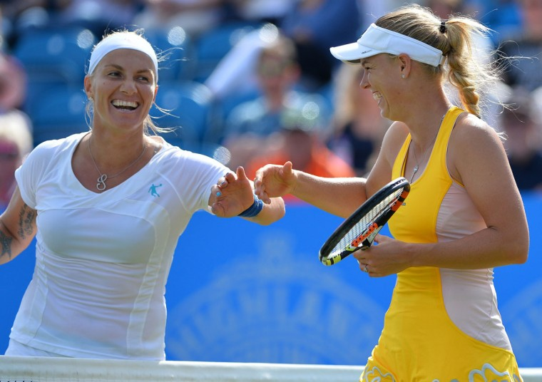 Denmark's Caroline Wozniacki (right) and Russia's Svetlana Kuznetsova react after both coming into the net to play shots during their women's singles third round match at the WTA Eastbourne International tennis tournament in Eastbourne, southern England on June 24, 2015. Wozniacki wom the match 6-7, 6-3, 6-1. (GLYN KIRK/AFP/Getty Images)