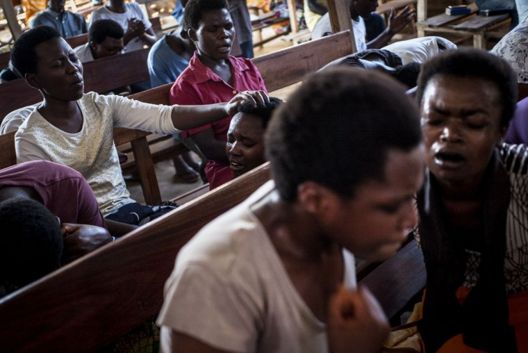 Christian worshippers prays at a church in the flashpoint neighborhood of Musaga in Bujumbura on June 24, 2015. (MARCO LONGARI/AFP/Getty Images)