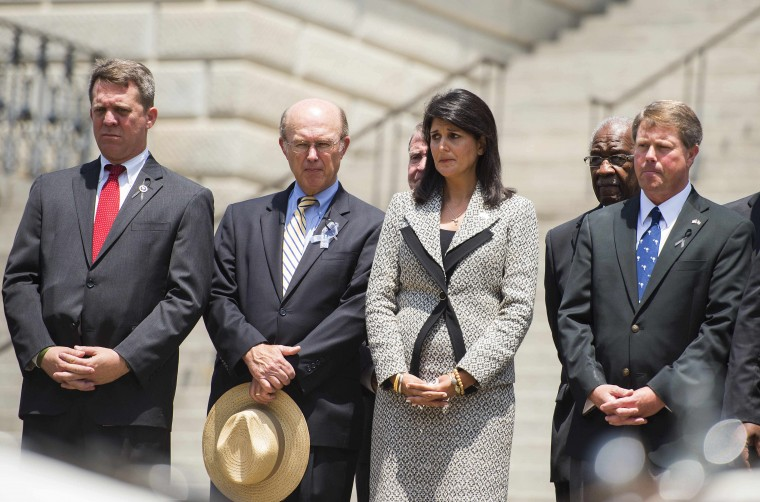 South Carolina Governor Nikki Haley (C) watches as the casket holding Emanuel AME Church pastor and South Carolina State Sen. Clementa Pinckney as it arrives at the steps of the South Carolina State House in Columbia, South Carolina, on June 24, 2015. Pinckney was one of nine people killed during a Bible study inside Emanuel AME church in Charleston. Pressure is growing in South Carolina to take down the Confederate flag that has flies on the front lawn of its State House in Columbia, also alongside a Confederate war memorial. (Jim Watson/AFP/Getty Images)