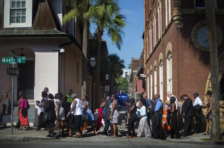 Members of the public stand in line to attend Emanuel AME Church Pastor and State Sen. Clementa Pinckney's funeral at College of Charleston's T D Arena in Charleston, South Carolina, June 26, 2015. (AFP Photo/P /jim )