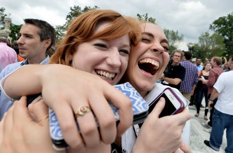 Two women celebrate outside the Supreme Court in Washington DC on June 26, 2015 after its historic decision on gay marriage. The US Supreme Court ruled Friday that gay marriage is a nationwide right, a landmark decision in one of the most keenly awaited announcements in decades and sparking scenes of jubilation. The nation's highest court, in a narrow 5-4 decision, said the US Constitution requires all states to carry out and recognize marriage between people of the same sex. (AFP Photo/P / )