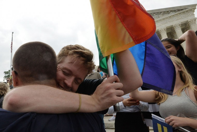 People celebrate outside the Supreme Court in Washington, DC on June 26, 2015 after its historic decision on gay marriage. The US Supreme Court ruled Friday that gay marriage is a nationwide right, a landmark decision in one of the most keenly awaited announcements in decades and sparking scenes of jubilation. The nation's highest court, in a narrow 5-4 decision, said the US Constitution requires all states to carry out and recognize marriage between people of the same sex. (AFP Photo/P / )