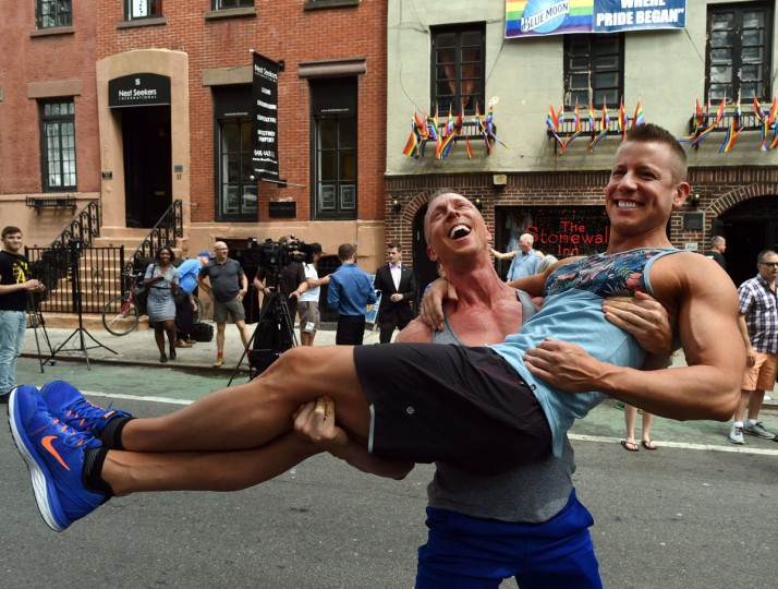 Justin Kattler and Tim Loecker from Dallas, Texas celebrate outside the Stonewall Tavern in the West Village in New York on June 26, 2015. The US Supreme Court ruled Friday that gay marriage is a nationwide right, a landmark decision in one of the most keenly awaited announcements in decades and sparking scenes of jubilation. The nation's highest court, in a narrow 5-4 decision, said the US Constitution requires all states to carry out and recognize marriage between people of the same sex. (AFP Photo/ a. clarytimothy a. clary)