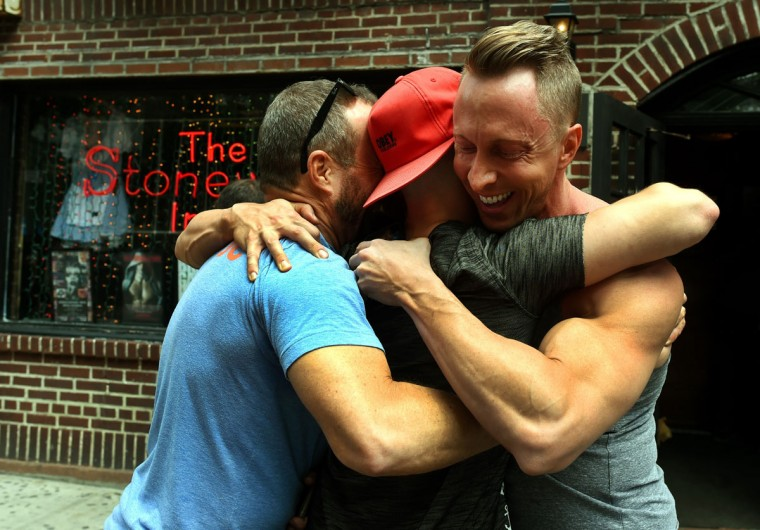 Men celebrate outside the Stonewall Tavern in the West Village in New York on June 26, 2015. The US Supreme Court ruled Friday that gay marriage is a nationwide right, a landmark decision in one of the most keenly awaited announcements in decades and sparking scenes of jubilation. The nation's highest court, in a narrow 5-4 decision, said the US Constitution requires all states to carry out and recognize marriage between people of the same sex. (AFP Photo/ a. clarytimothy a. clary)