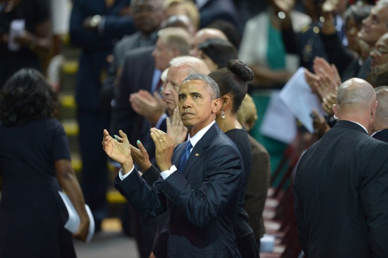 US President Barack Obama claps his hands before he delivers the eulogy during the funeral of slain South Carolina State Sen and Rev.Clementa Pinckney, at the College of Charleston TD Arena, in Charleston, South Carolina on June 26, 2015. (AFP Photo/P /mandel )