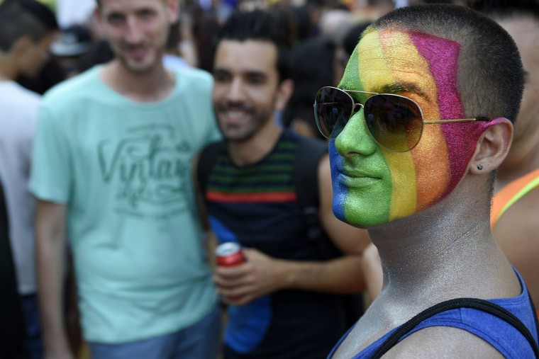 A man with a rainbow colours painted on his face looks on as he takes part in the Gay Pride parade in Barcelona on June 27, 2015, one day after the US Supreme Court legalised same-sex marriage nationwide. (Lluis Gene/AFP/Getty Images)