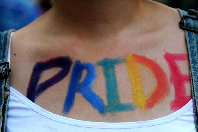 """A woman takes part in the Gay Pride parade with the word """"Pride"""" painted on her body on June 28, 2015 at the Cihangir neighborhood near the Taksim square in Istanbul. Riot police in Istanbul used teargas and water cannon to disperse thousands of participants in the Gay Pride parade in the Turkish city, an AFP reporter said. Police took action against the crowd when demonstrators began shouting slogans accusing the social conservative President Recep Tayyip Erdogan of """"fascism"""". (Ozan Kose/AFP/Getty Images)"""