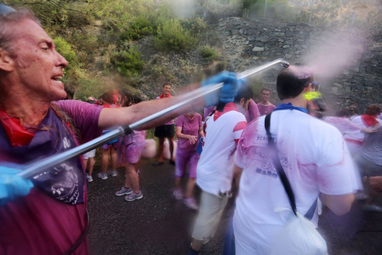 "A man sprays red wine on revelers during the""Batalla del Vino"" (Battle of Wine) in Haro, on June 29, 2015. (CESAR MANSO/AFP/Getty Images)"